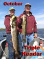 Don & Jerry with a trophy pike and walleye triple header. The pike grabbed Jerrys walleye on the way in